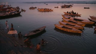 VARANASI, INDIA - 22 FEBRUARY 2015: People bathing in Ganges river in Varanasi at sunset.