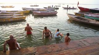 VARANASI, INDIA - 22 FEBRUARY 2015: People bathing in the Ganges river in Varanasi.