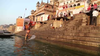 VARANASI, INDIA - 22 FEBRUARY 2015: View on people at ghats of the Ganges river from the water.