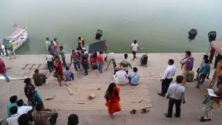 VARANASI, INDIA - 25 FEBRUARY 2015: People filming video at ghat by Ganges in Varanasi.