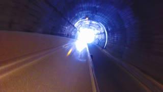 Vehicle driving through tunnel in Sri Lanka.