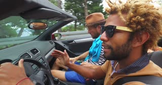 Black handsome men driving his friends in convertible