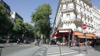 Busy street cafe corner in the centre of Paris