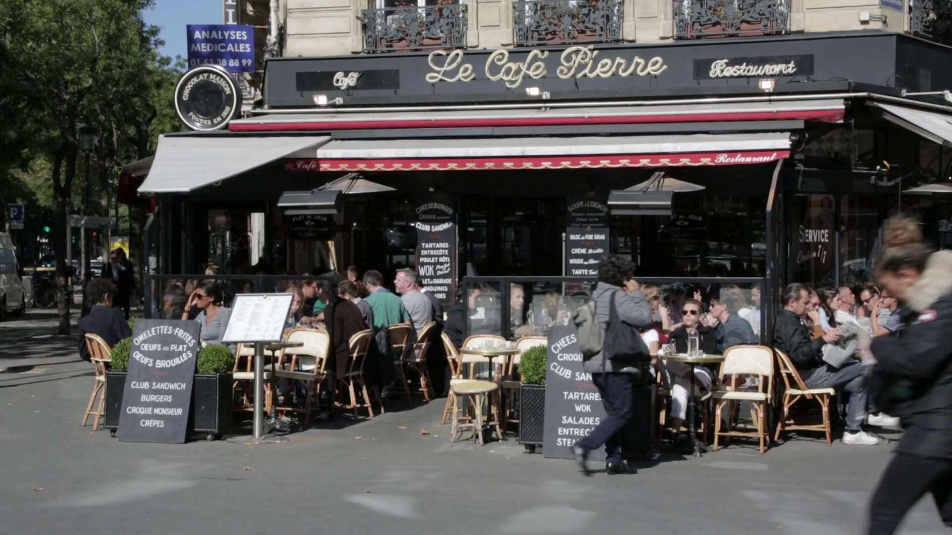 Busy street cafe in the centre of Paris Stock Video Footage   Storyblocks