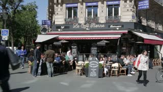 Busy street cafe in the centre of Paris