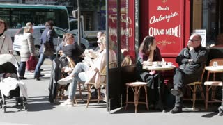 Busy street cafe with elderly woman pushing stroller in the centre of Paris