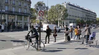 Pedestrians and cyclists crossing at zebra traffic lights