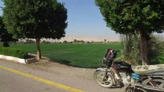 View from car on agricultural fields in Luxor, Egypt