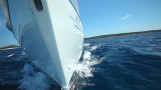 View from front of moving sailing boat on Adriatic sea in Croatia