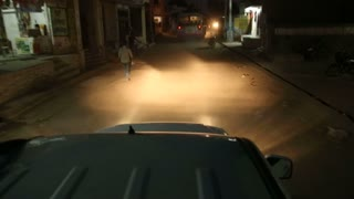 View from the car roof while ride through dark street in Jodhpur.