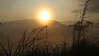 View of a foggy sunrise on the Little Adam's Peak in Ella. Ella is a beautiful small sleepy town on the southern edge of Sri Lanka's Hill Country.