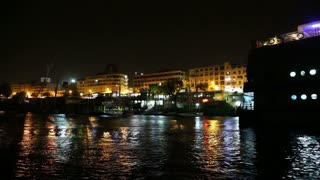 View of anchored cruise ships on the Nile river during the night