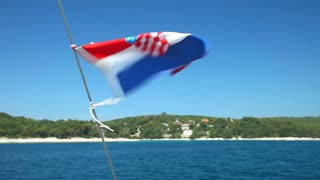 View of Croatian flag from sailboat on Adriatic sea in Croatia