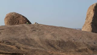 View of famous temple and large stones in Indian village Hampi.
