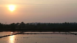 View of landscape at sunset in Goa, above water dams.
