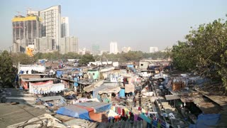 View of the slums in mumbai with highrise building in background