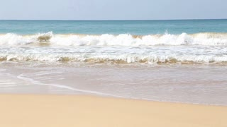 View of the waves breaking on sandy beach of Mirissa, Sri Lanka.
