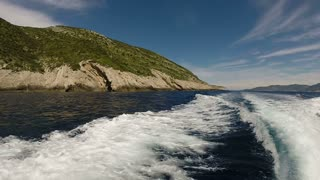 View of waves behind speed boat