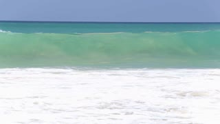 View of waves crashing on beach sandy beach
