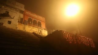 View on foggy street and stairs in Varanasi in night time.