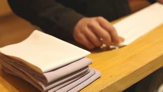 Waiter folding napkins