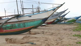 WELIGAMA, SRI LANKA - MARCH 2014: View of wooden fishing boats on beach. The term Weligama literally means