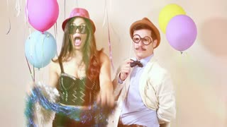Woman and man having awesome time in photo booth