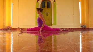 Woman doing yoga in ashram in Goa, India