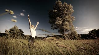 Woman doing yoga in the middle of a field of high grass - sepia style grading - slow motion