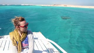 Woman enjoying on a boat sailing in the Red sea, Egypt