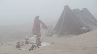 Woman with children in a tent by the shore of Ganges in Varanasi.