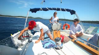 Young adults enjoying a trip on sailing boat on the Adriatic sea in Croatia.
