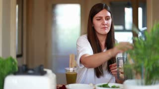 Young brunette woman drinking green smoothie