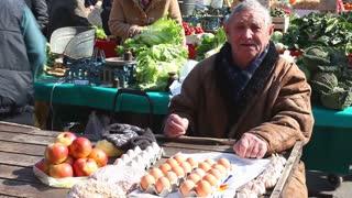 ZAGREB, CROATIA - JUNE 21: Man selling local produce on Dolac market in Zagreb, Croatia on June 21, 2012. Dolac is the largest farmer's market in Zagreb.