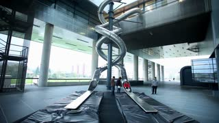 ZAGREB, CROATIA - OCTOBER 5, 2014: People on slide at Museum of Modern Art in Zagreb. It is the biggest and most modern museum in the country.
