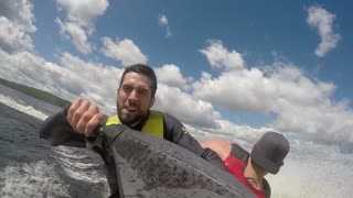 Action Sports Jet Ski Seadoo rider - man falls off back