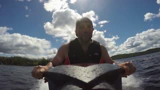 Action Sports Jet Ski Seadoo rider racing around the lake on his pleasure craft