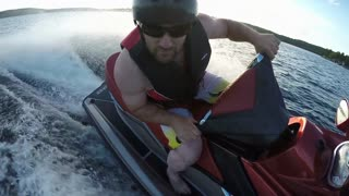 Action Sports Jet Ski Seadoo rider racing around the lake on his pleasure craft
