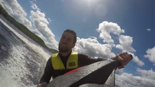 Action Sports Jet Ski Seadoo rider racing around
