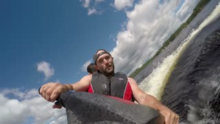 Action Sports Jet Ski Seadoo rider - slow motion falling off boat