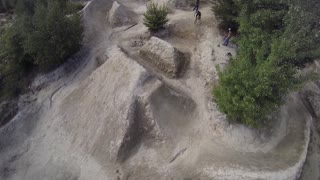 Aerial of BMXer doing a 360 on a big dirt jump - Extreme Sport