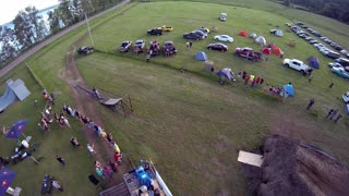 Aerial of Motocross Jumper doing tricks for a crowd