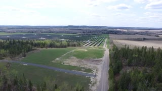 Aerial of Northern Ontario Canada Solar Farm - Panels in a Coniferous forest