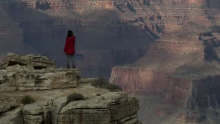 America's Grand Canyon - Young woman standing on edge of south rim
