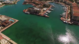 Beautiful Condominiums And Boats On The Shore Of Dominican Republic