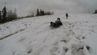 Brother And Sister Sledding Boy On The Hill Falls