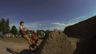 Extreme Sport BMX Bike Rider doing Tricks
