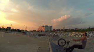 Extreme Sport BMX Biker Back Flip Trick in Skateboard Park