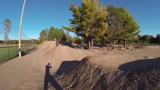 Extreme sport BMX rider on dirt jump