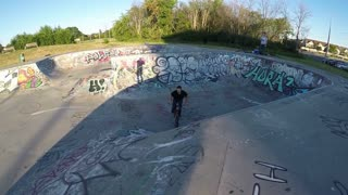 Extreme Sport BMX trick - Double Bar Spin